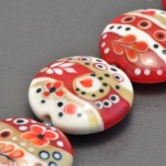 Red and cream squiggle beads